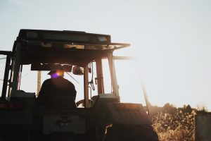 farmer in his tractor out and about on the farm